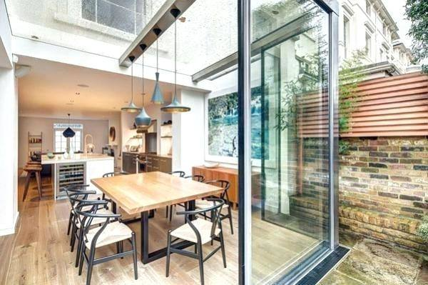 Victorian terraced house with open plan living room/ dining room and kitchen diner with concertina doors opening up onto the garden