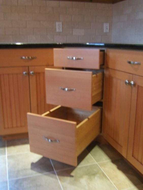 Remodeled kitchen with cabinet drawer for waste and recyclable baskets by Neal's Design Remodel