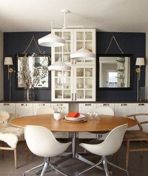 Tom Dixon copper lamps and bold patterned wallpaper create a striking setting