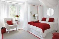 The soft shade of grey behind the bed contrasts against the cream walls wonderfully