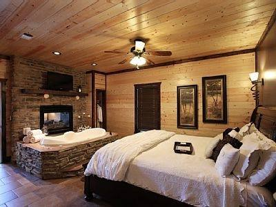 Romantic bedroom with a king size bed, jacuzzi tub and fireplace in the bedroom
