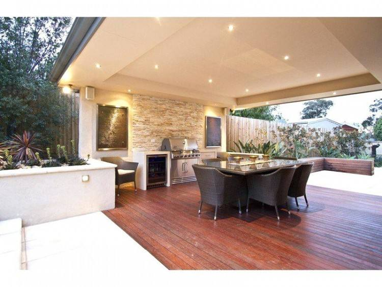 Covered outdoor living space with BBQ and fireplace