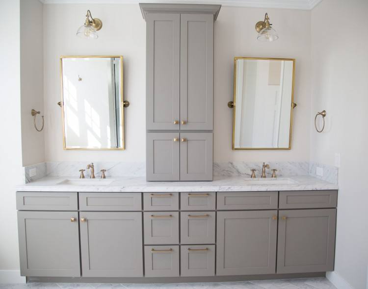 Carrara marble and grey master bathroom with antique brass accents by Rafterhouse
