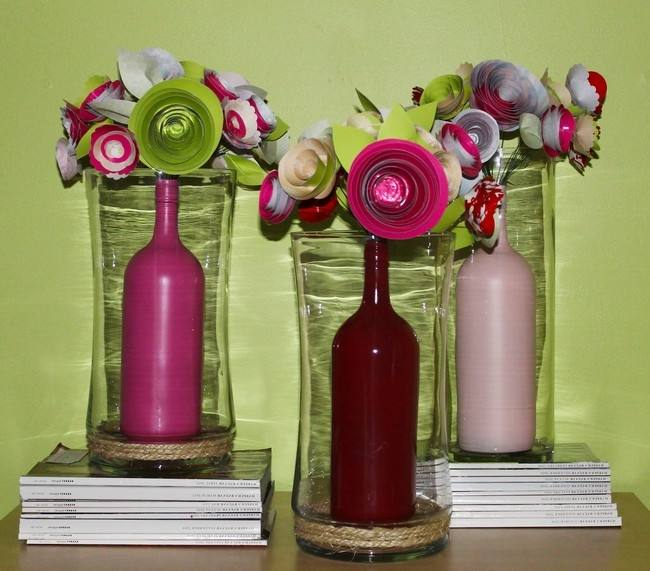 Clear tall cylindrical vases with fruit inside