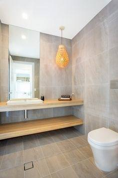 White oak bathroom cabinet with marble countertop and