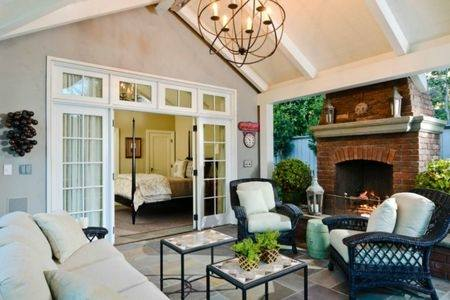 They often include a grill, seating, a covered patio area,