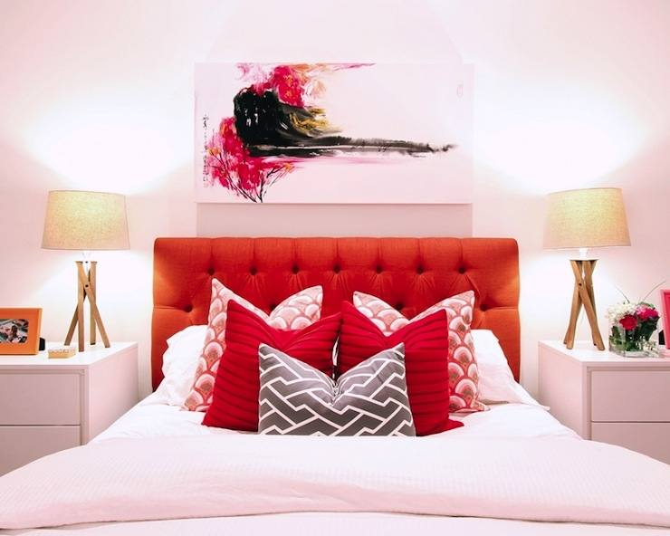 Make a clean and minimalistic red bedroom design by painting your walls red and using all white furniture and decor