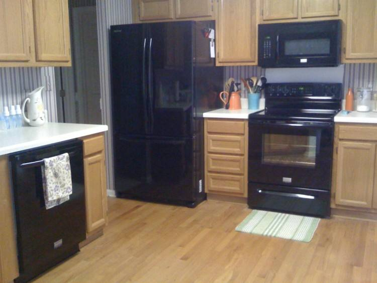 black appliances to cut down on finger prints with stainless steel | Home | Kitchen, Black appliances, Grey cabinets
