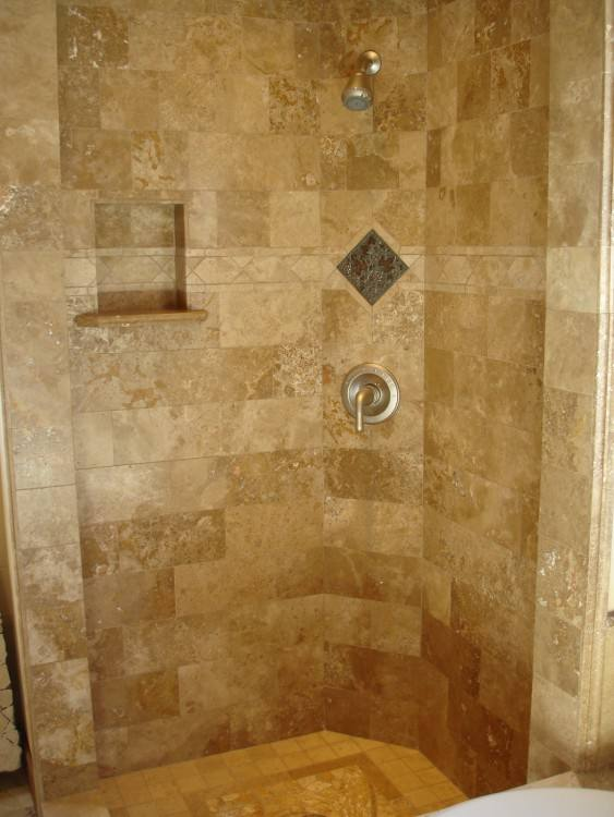 I like that the shower is open, and that the floor tile extends all the way up the back shower wall